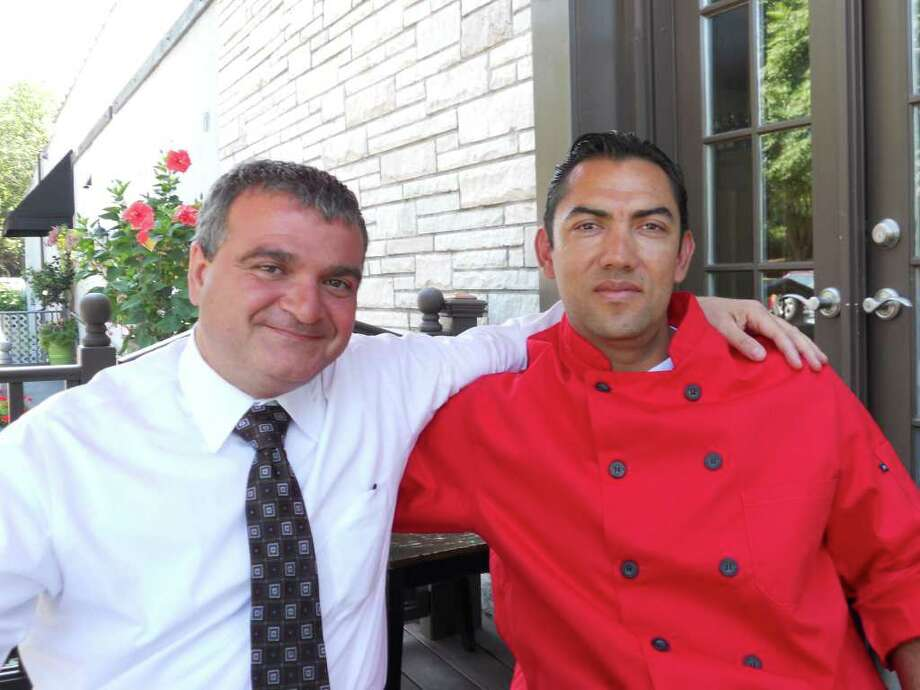 Angelo Capponi, left, and Henry Lopez on the patio of their new restaurant, Pane e Bene, on Post Road East in Westport. Photo: Patti Woods / Westport News contributed