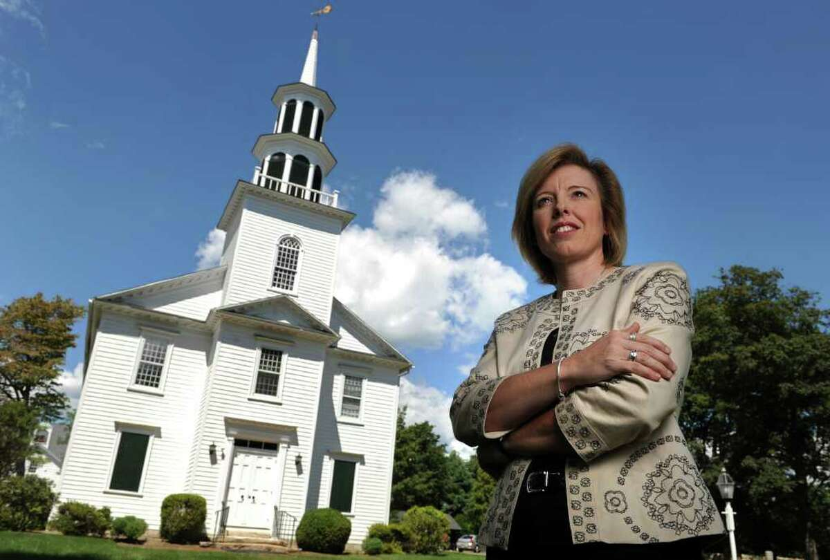 Rev. Diane Carter stands outside Norfield Congregational Church in Weston, Conn. where she is a minister. Her experience as a volunteer firefighter responding in the relief efforts at Ground Zero impacted her decision to become a minister.