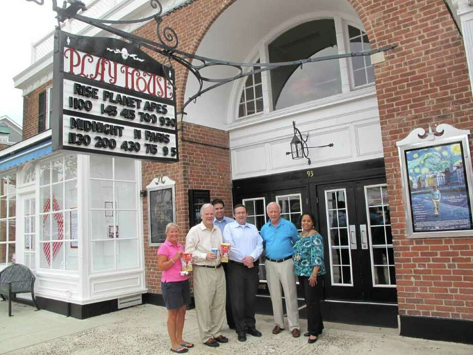 Executive Director of the Chamber of Commerce Tucker Murphy, Town Administrator Tom Staddler, Bow Tie Cinemas Director of Operations Ike Rivera, Bow Tie Cinemas Chief Operating Officer Joseph Masher, First Selectman Jeb Walker and New Canaan Playhouse General Manager Janet Amezquita stand outside the new and improved theater. Photo: Paresh Jha