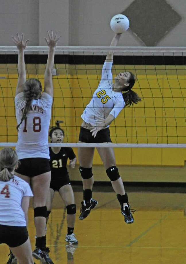 Klein Oak junior hitter Jade Larimore (25) and junior libero Lexxi Pham (21) during the Spring Branch ISD Tournament on Aug. 20, 2011 at Spring Woods High School. Photo: L. Scott Hainline / freelance