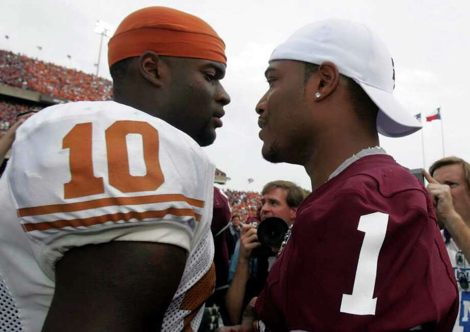 COLLEGE STATION, TX - NOVEMBER 25:  Quarterback Vince Young #10 of the Texas Longhorns meets with Reggie McNeal #1 of the Texas A&M Aggies at the end of the game on November 25, 2005 at Kyle Field in College Station, Texas.  The Longhorns defeated the Aggies 40-29.  (Photo by Ronald Martinez/Getty Images)  *** Local Caption *** Vince Young;Reggie McNeal Photo: Ronald Martinez, Staff / Getty Images North America