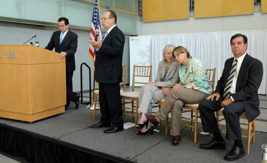 Connecticut Governor Dannel P. Malloy, left, speaks with UBS Americas Chief Executive of Phil Lofts in a press conference in the UBS building in Stamford on Tuesday, August 23, 2011. Photo: Lindsay Niegelberg / Stamford Advocate