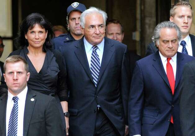 Dominique Strauss-Kahn leaves Manhattan State Supreme court with his wife Anne Sinclair, Tuesday, Aug. 23, 2011, in New York. A New York judge dismissed the sexual assault case against Strauss-Kahn, but the order is on hold until an appeals court rules on his accuser's request for a special prosecutor. (AP Photo/Louis Lanzano) Photo: Louis Lanzano