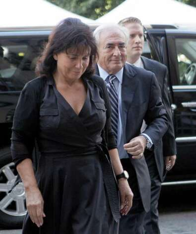 Former International Monetary Fund leader Dominique Strauss-Kahn arrives for a hearing at Manhattan state Supreme court with his wife Anne Sinclair in New York on Tuesday, Aug. 23, 2011. (AP Photo/Mary Altaffer) Photo: Mary Altaffer