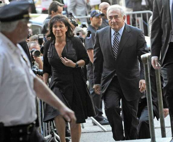 Dominique Strauss- Kahn arrives at Manhattan State Supreme court with his wife Anne Sinclair, Tuesday, Aug. 23, 2011, in New York. Strauss- Kahn, the former head of the International Monetary Fund, is hoping that the judge will agree to dismiss the sexual assault case brought against him by a hotel housekeeper. (AP Photo/Louis Lanzano) Photo: Louis Lanzano