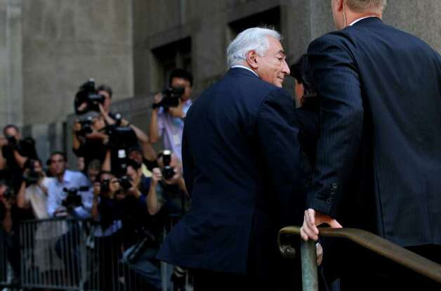 Dominique Strauss-Kahn enters the Criminal Courts Building in New York on Tuesday, Aug. 23, 2011. The case against Strauss-Kahn, who accused by Hotel housekeeper Nafissatou Diallo of sexual assault, was expected to be dismissed. (AP Photo/Craig Ruttle) Photo: Craig Ruttle