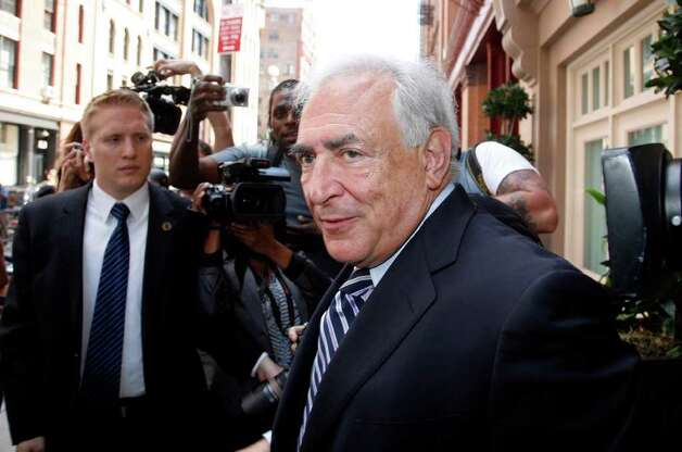 Former International Monetary Fund leader Dominique Strauss-Kahn speaks outside the building where he has been living in New York after a hearing at Manhattan state Supreme court Tuesday, Aug. 23, 2011.  A New York judge dismissed the sexual assault case against Strauss-Kahn, but the order is on hold until an appeals court rules on his accuser's request for a special prosecutor. (AP Photo/David Karp) Photo: David Karp