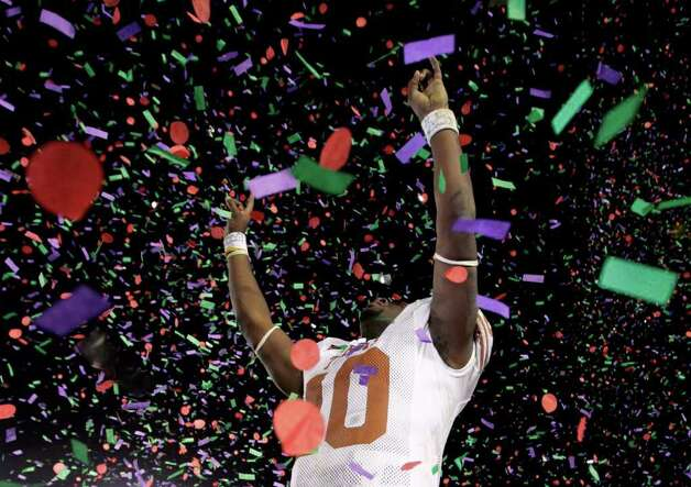Vince Young rejoices after leading the Texas Longhorns to a 41-38 win over vaunted Southern California in the 2006 Rose Bowl. Photo: Mike Blake/Reuters / X00030