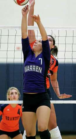 Warren's Ariana Gallardo sets up a shot during the Warriors' victory over Brandeis on Tuesday, Aug. 23, 2011 at O'Connor Gym. The victory was Warren's first in district play against the Broncos in seven tries. Photo: Tom Reel/treel@express-news.net / © 2011 San Antonio Express-News