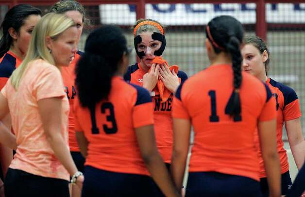 Brandeis takes a time out during the Warren's victory on Tuesday, Aug. 23, 2011 at O'Connor Gym. The victory was the Warriors' first in district play against the Broncos in seven tries. Photo: Tom Reel/treel@express-news.net / © 2011 San Antonio Express-News