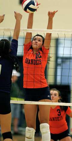 Brandeis' Cassidy Acord stops a shot at the net during the Broncos' loss to Warren  on Tuesday, Aug. 23, 2011 at O'Connor Gym. Photo: Tom Reel/treel@express-news.net / © 2011 San Antonio Express-News