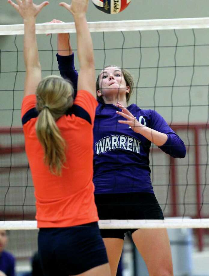 Warren's Shelby Aelvoet slams a spike against Brandeis during the Warriors' victory on Tuesday, Aug. 23, 2011 at O'Connor Gym. The victory was Warren's first in district play against the Broncos in seven tries. Photo: Tom Reel/treel@express-news.net / © 2011 San Antonio Express-News