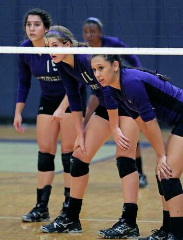 Warren players wait for the serve during their victory over Brandeis on Tuesday, Aug. 23, 2011 at O'Connor Gym. The victory was Warren's first in district play against the Broncos in seven tries. Photo: Tom Reel/treel@express-news.net / © 2011 San Antonio Express-News