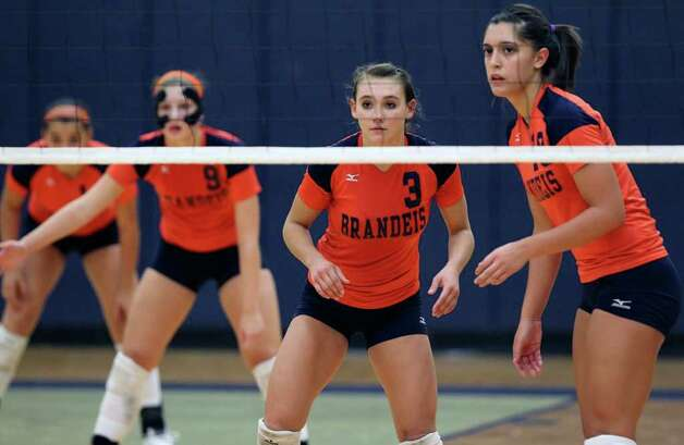 Brandeis players wait for the serve during their loss to Warren on Tuesday, Aug. 23, 2011 at O'Connor Gym. The victory was Warren's first in district play against the Broncos in seven tries. Photo: Tom Reel/treel@express-news.net / © 2011 San Antonio Express-News