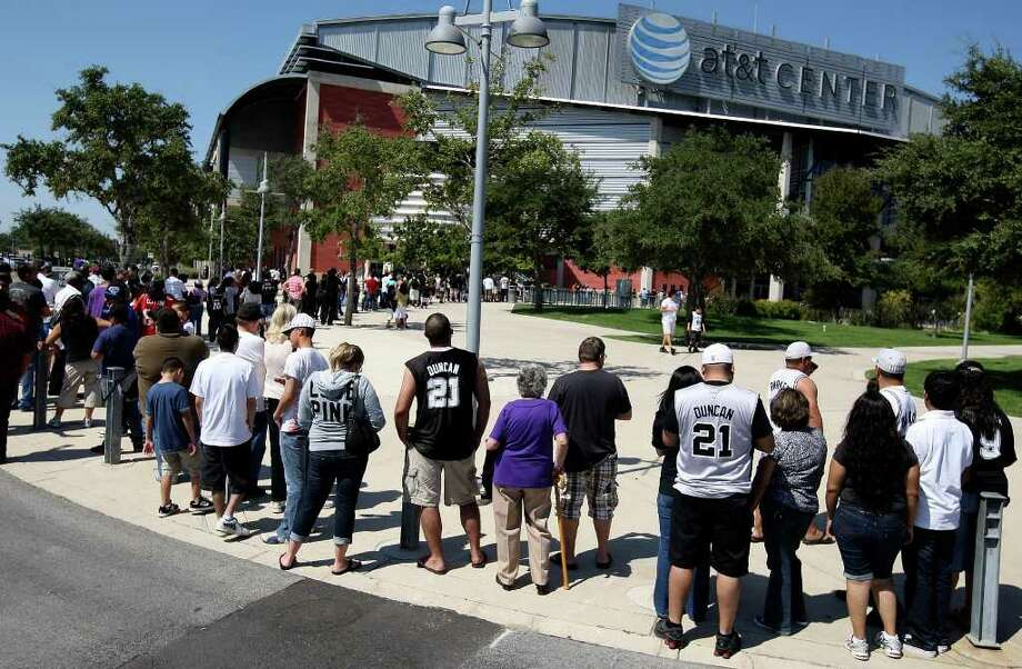 Spurs fans wait in line in October 2010 to enter the AT&T Center for a Spurs practice. With an eye fixed on an NBA lockout, Bexar County has asked the Spurs to re-evaluate when the organization expects to begin spending $75 million in bond money earmarked for capital improvements at the county-owned AT&T Center. Photo: Edward A. Ornelas/eaornelas@express-news.net / eaornelas@express-news.net