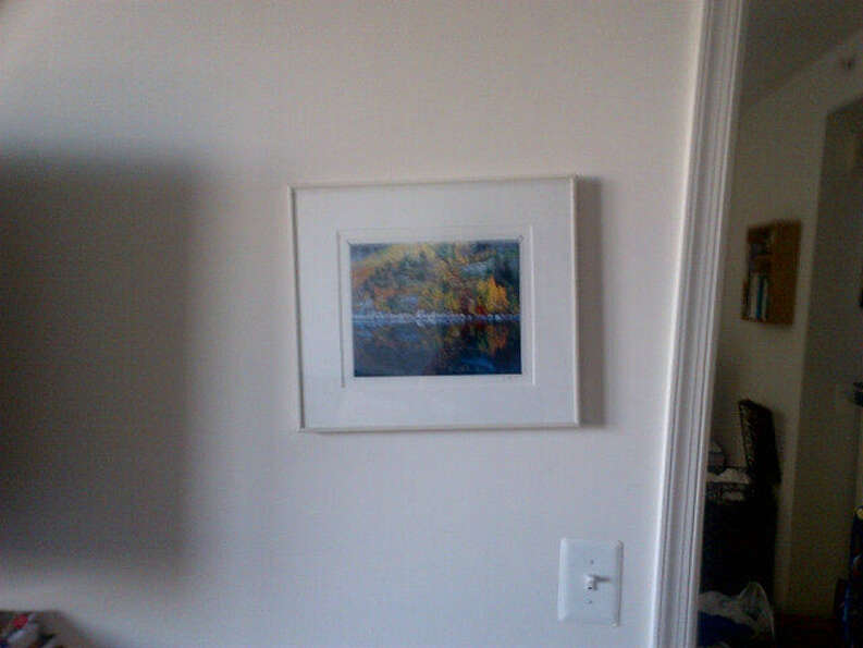 Alert: Picture frame knocked off-center. Photo via