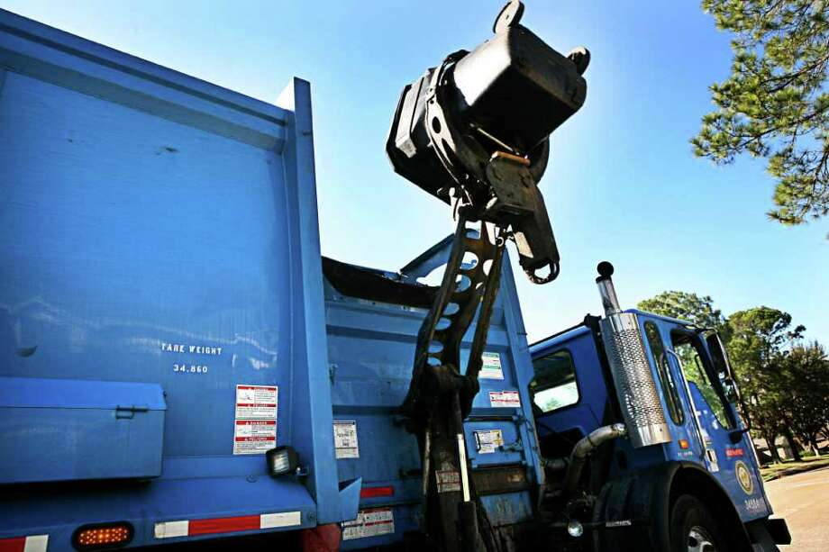 Garbage trucks similar to this one will begin collecting trash in Sugar Land in December using mechanical arms. Photo: ERIN TRIEB, Freelance / Freelance