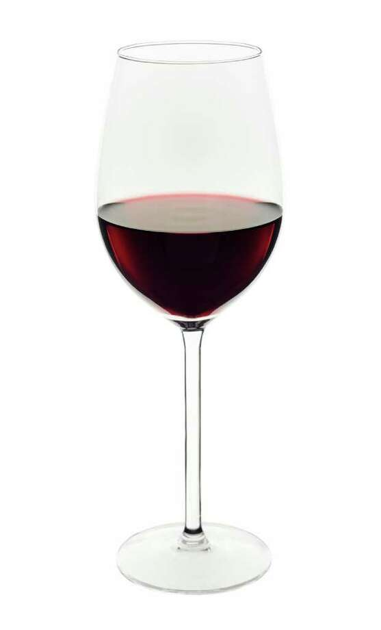 red wine glass on white background / handout / stock agency