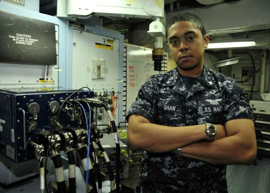 PACIFIC OCEAN (June 24,2011) - Aviation Electronics Technician 3rd Class Gregory Shaw works in shop 8 where he maintains, troubleshoot, calibrate, and repair 19 consolidate automated support system in direct support of aircraft intermediate maintenance department and carrier air wing 5 onboard the nuclear powered aircraft carrier USS George Washington (CVN 73.) USS George Washington began its summer patrol on June 12, 2011, departing its forward-operating base of Commander, Fleet Activities Yokosuka. Onboard are more than 5,500 Sailors from George Washington and Carrier Air Wing FIVE. George Washington's mission is to patrol the western Pacific, work with regional partners and help ensure security, stability and respond to any crisis across the operational spectrum as directed. (U.S. Navy photo by Mass Communication Specialist Seaman Cheng Yang/RELEASED) Photo: (U.S. Navy Photo By Mass Communi