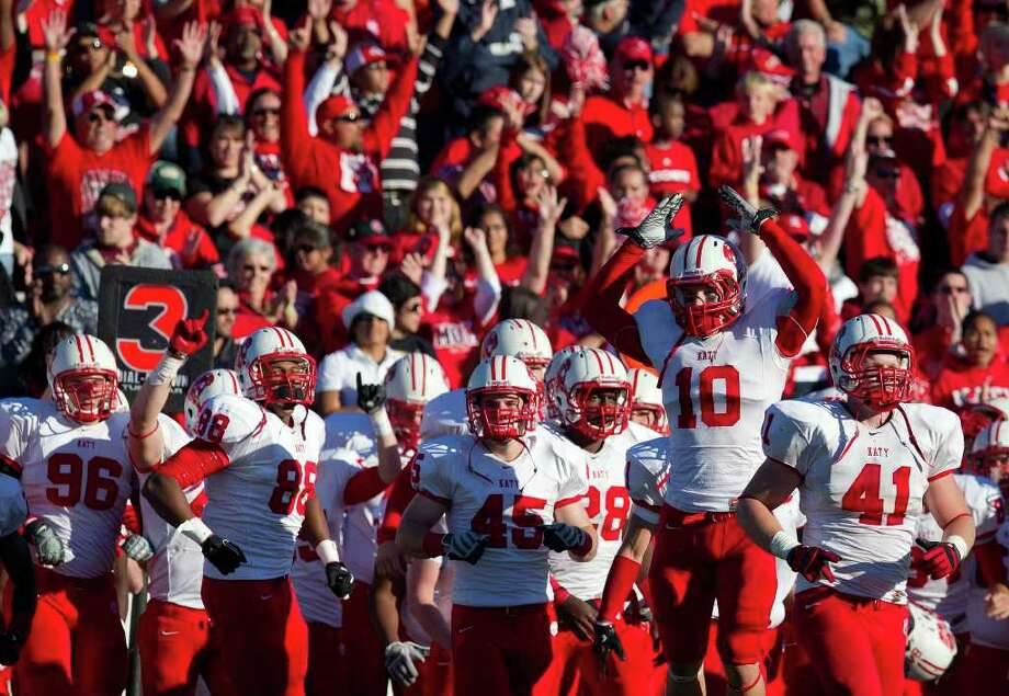 The Katy Tigers bench celebrates as time expires on the fourth quarter of their victory over North Shore Mustangs in high school football playoff action at  Pasadena Memorial Stadium Saturday, Nov. 27, 2010, in Pasadena. Katy won the game 32- 27. ( Smiley N. Pool / Houston Chronicle ) Photo: Smiley N. Pool, HC Staff / Houston Chronicle