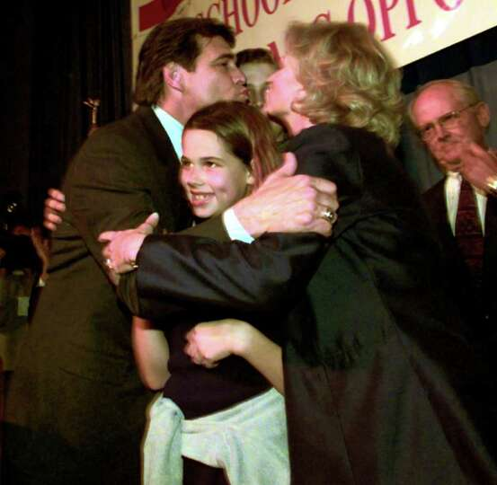 Rick Perry Republican candidate for Texas Lt. Gov. gets a kiss from wife Anita while hugging daughte