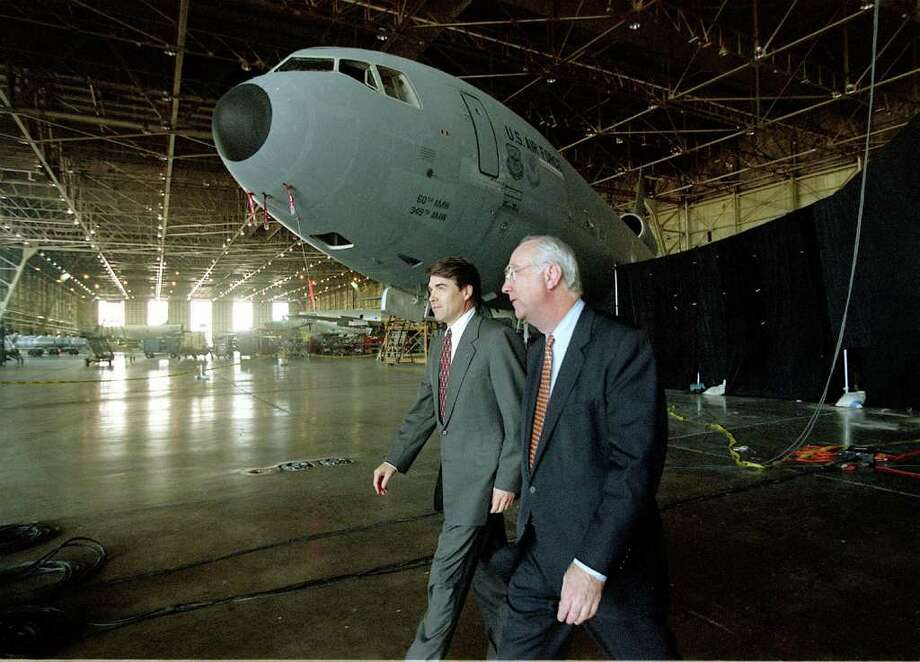 Lt. Gov. Rick Perry and U.S. Senator Phil Gramm, walk to a press briefing area in a hanger in Kelly during 1st anniversary of Boeing Aeorspace Support Center, Aug. 10,1999, in San Antonio.