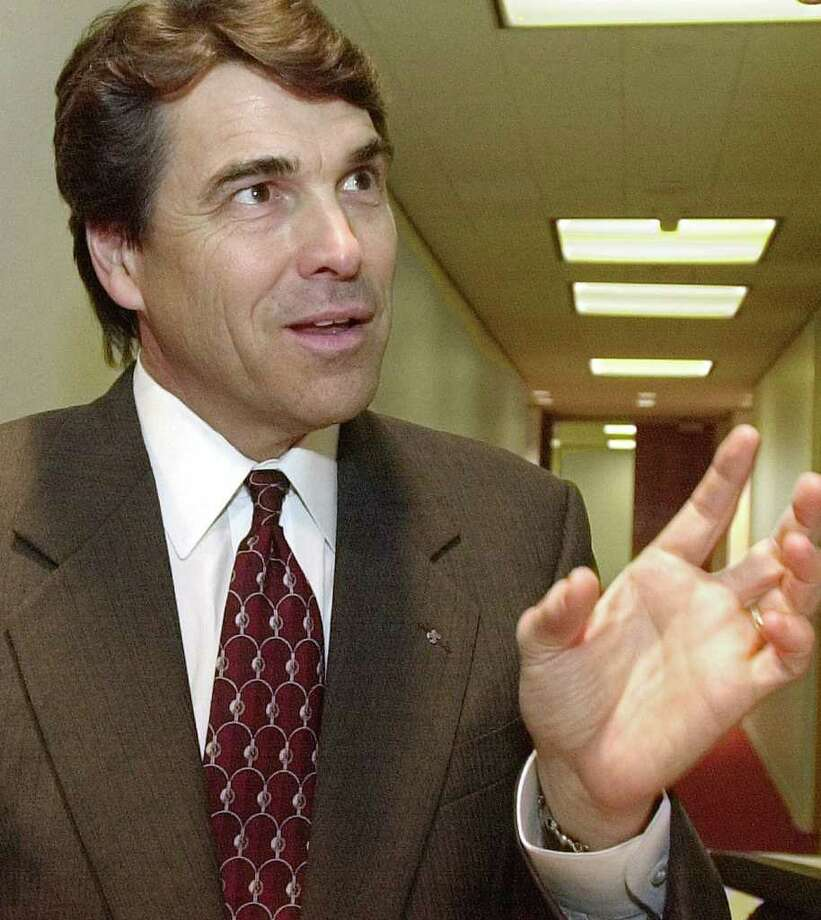 Texas Lt. Gov. Rick Perry makes a point during an interview following his speech to a gathering of environmental leaders, Aug. 22, 2000, in Houston. Photo: PAT SULLIVAN, AP / AP