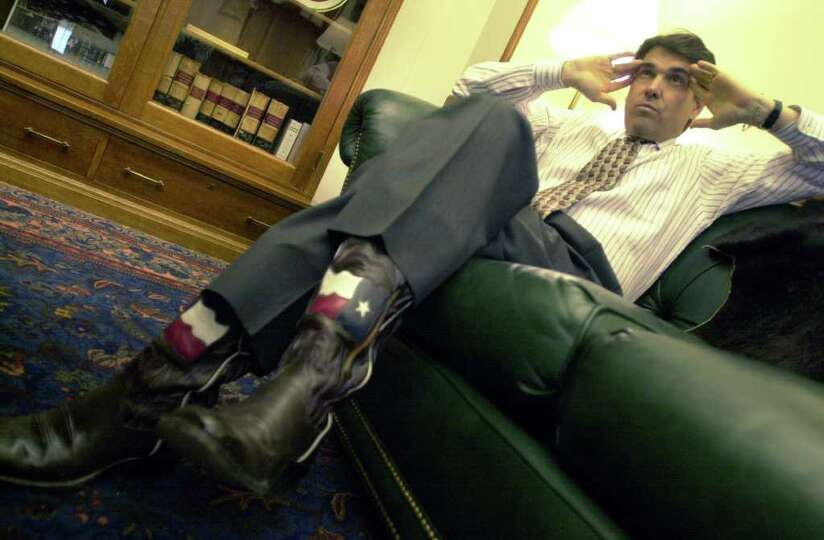 Gov. Rick Perry answers questions in his office, Jan. 9, 2001 in Austin.