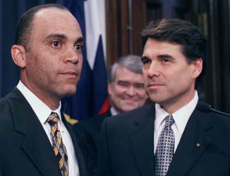 San Antonio attorney Wallace Jefferson, left, listens to a question after being introduced as nominee to the Texas Supreme Court by Texas Gov. Rick Perry during a news conference, March 14, 2001, in Austin. If confirmed by the Texas Legislature Jefferson would be the first black to serve on the state's highest court. In background is Supreme Court Justice Nathan Hecht. Photo: HARRY CABLUCK, AP / AP