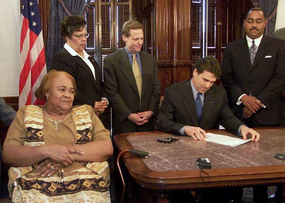 Stella Byrd (left) mother of James Byrd, Jr., the East Texas black man who was dragged to his death from a pickup truck in 1998 by three anglos, waits as Gov. Rick Perry signs into law the James Byrd Jr. Hate Crimes Act at the Capitol in Austin, May 11, 2001. Gov. Perry signed the bill into law which strengthens the penalties for offenses against minorities, gays and others. Also shown (from left) are Rep. Senfronia Thompson, D-Houston; Rep. Steve Wolens, D-Dallas, and Sen. Rodney Ellis, D-Houston, from left. Photo: DEBORAH CANNON, AP / AP
