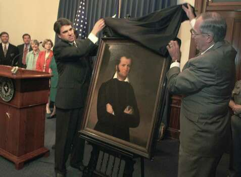 Gov. Rick Perry and John Nau, Chairman of the Texas Historical Commission, unveil a portrait of Texas pioneer and icon James Bowie at the capitol in Austin.  Photo: JOHN DAVENPORT, SAN ANTONIO EXPRESS-NEWS / SAN ANTONIO EXPRESS-NEWS