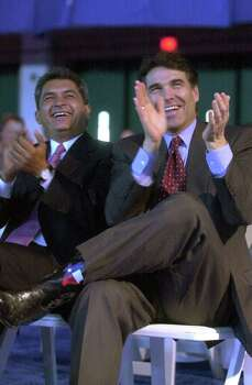 Gov. Rick Perry and Tamaulipas, Mexico, Gov. Tomas Yarrington laugh as they listen to a speech by Fernando Canales Clariond, governor of the Mexican state of Nuevo Leon, during a luncheon at U.S.-Mexico Border Summit in Edinburg, Aug. 22, 2001.  Photo: BILLY CALZADA, SAN ANTONIO EXPRESS-NEWS / SAN ANTONIO EXPRESS-NEWS