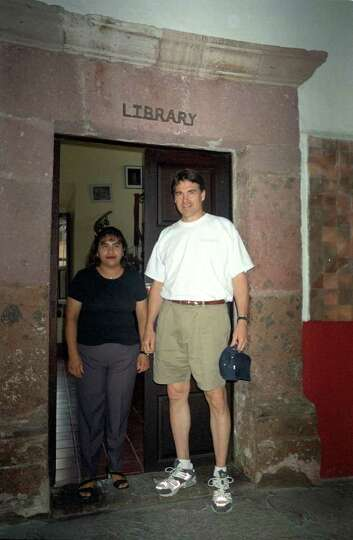 Texas Gov. Rick Perry poses with one of his three Spanish teachers at the Instituto Allende in San M