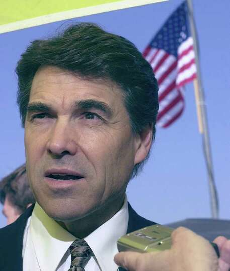 Texas Gov. Rick Perry talks to reporters Sept. 13, 2001, in Austin.  Gov. Perry  spoke before joinin