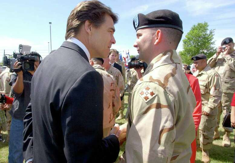 Gov. Rick Perry wishes Army Warrant Officer Taylor Petty of San Antonio well at farewell ceremonies