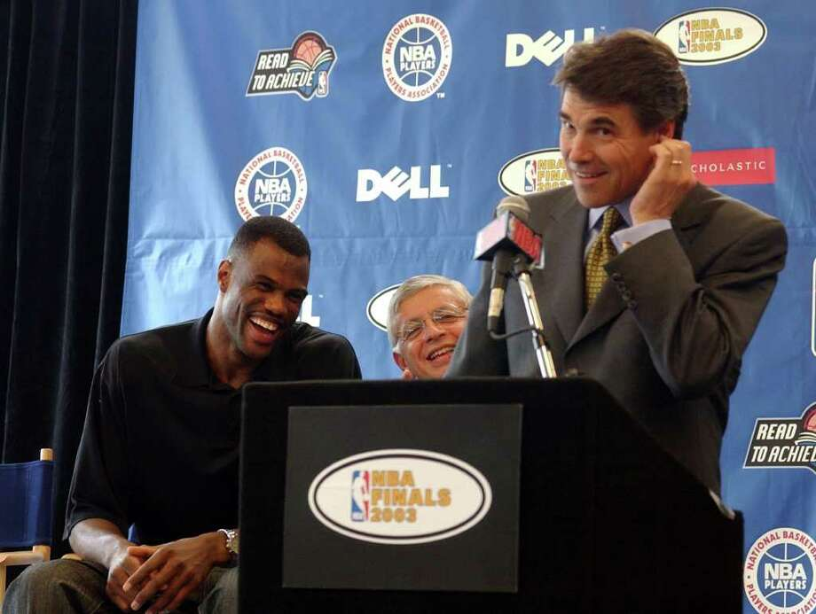 David Robinson and NBA Commissioner David Stern laugh at a joke by Gov. Rick Perry at the dedication ceremony, June 5, 2003, of the Spurs Reading and Learning Center at Carver Academy, which Robinson founded. Photo: BAHRAM MARK SOBHANI, SAN ANTONIO EXPRESS-NEWS / SAN ANTONIO EXPRESS-NEWS