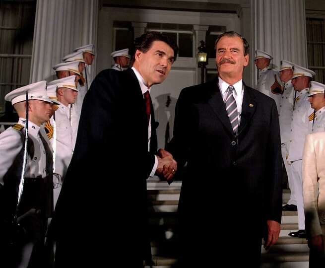 Texas Gov. Rick Perry welcomes Mexican President Vicente Fox at the Governor's Mansion in Austin, No