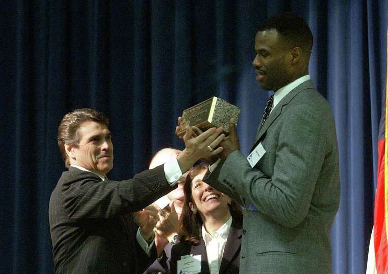 Former San Antonio Spurs player David Robinson receives the Texan of the Year award from Gov. Rick P