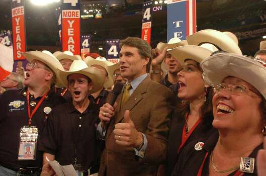 Gov. Rick Perry announces the state's votes in favor of President George W. Bush during the roll call of states in  the 2004 Republican National Convention at Madison Square Garden in New York, Aug. 31, 2004. Photo: JERRY LARA, SAN ANTONIO EXPRESS-NEWS / SAN ANTONIO EXPRESS-NEWS