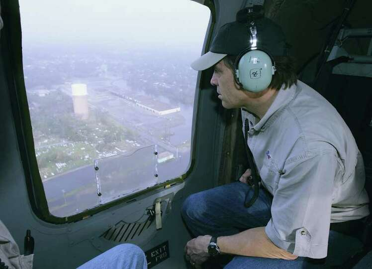 Texas Gov. Rick Perry views the damage caused by Hurricane Rita during a flight over a flooded area