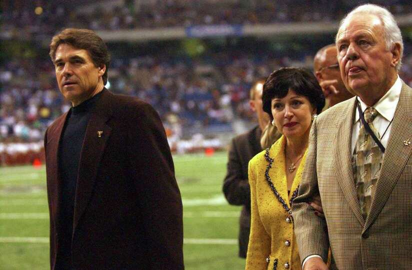 Gov. Rick Perry and New Orleans Saints owner Tom Benson leave the field after a pregame ceremony, Oc