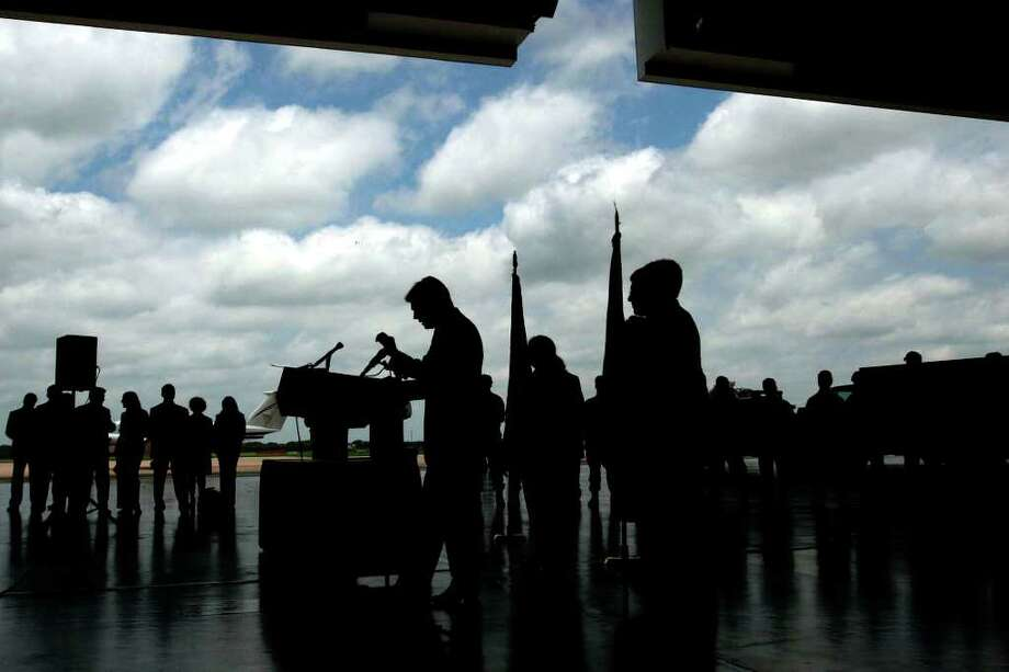 Gov. Rick Perry speaks during a bill-signing ceremony at the old Kelly AFB, June 6, 2007. The border security bill gives 100 million dollars to local law enforcement first responders.  Photo: NICOLE FRUGE, SAN ANTONIO EXPRESS-NEWS / SAN ANTONIO EXPRESS-NEWS
