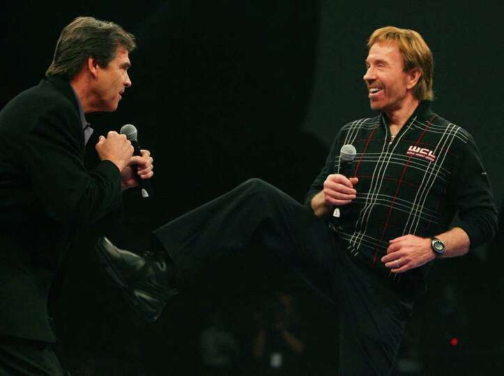 Governor Rick Perry (left) and Chuck Norris joke prior to the start of the World Combat League fight