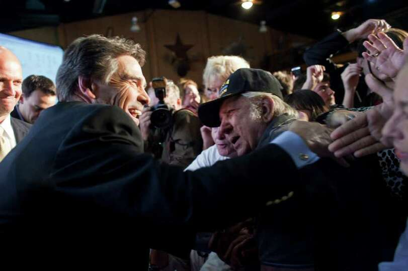 BTexas Gov. Rick Perry shakes hands with supporters at the Victory Texas and Republican Party of Tex