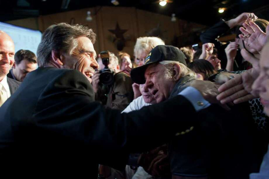 BTexas Gov. Rick Perry shakes hands with supporters at the Victory Texas and Republican Party of Texas election night watch party at the Texas Disposal Systems Exotic Game Ranch, Nov. 2, 2010, in Buda, Texas. Gov. Perry had been elected to his third term by defeating Democratic challenger Bill White. Photo: Ben Sklar, Getty Images / 2010 Getty Images