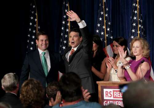 Texas Gov. Rick Perry, center, waves to the crowd after announcing his run for president in 2012 at the RedState Gathering Saturday, Aug. 13, 2011, in Charleston, S.C. Perry is accompanied by (from left) his son Griffin, his daughter-in-law Meredith, his daughter Sydney, and wife, Anita. Photo: AP