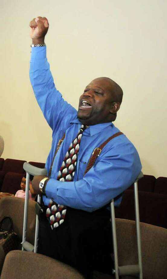 Reggie Harper joins the praise and worship portion of the St. Luke Missionary Baptist Church's Sunday's service celebrating the move to their new location. Freelance photo by Jerry Baker Photo: Jerry Baker, Freelance
