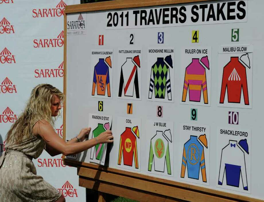 NYRA TV personality Maggie Wolfendale places the last set of colors on the post position board during the Post Position Draw Aug 24, 2011,  for 142rd Travers Stakes which will be held Saturday at the Saratoga Race Course in Saratoga Springs, N.Y.. (Skip Dickstein / Times Union) Photo: SKIP DICKSTEIN