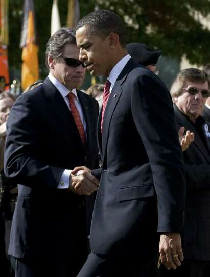 President Barack Obama shakes hands with Texas Gov. Rick Perry after addressing the Fort Hood commun
