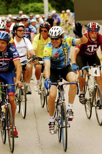 Texas Governor Rick Perry rides during the final leg of the 20th annual BP MS 150 April 18, 2004, in